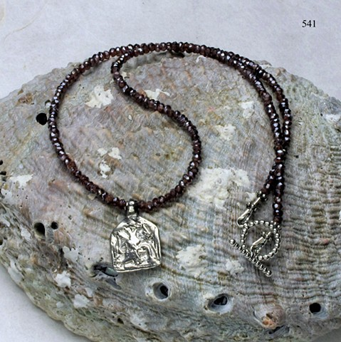 dainty choker of annodized faceted garnets w/ antique silver Indian charm, finished with a silver toggle (#541)