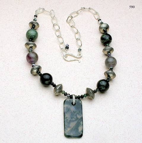green agate pendant is paired with large round assorted agate beads, small faceted ruby zoisite and Mali tribal silver beads, the necklace is finished with a silver link chain with a forged hook clasp (adjustable in length) (#590)