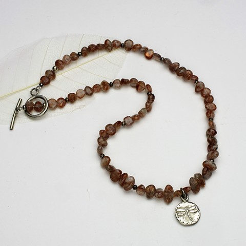 a sterling dragonfly pendant centers this 19' necklace of translucent sunstone tumbled nuggets & silver beads, finished with a sterling toggle. (#975)