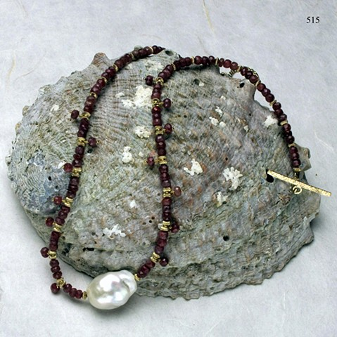 understated elegance; faceted ruby choker w/ baroque pearl centerpiece, accented by dangling rubies and g/f findings (#515)  coordinate with earrings, see #725E