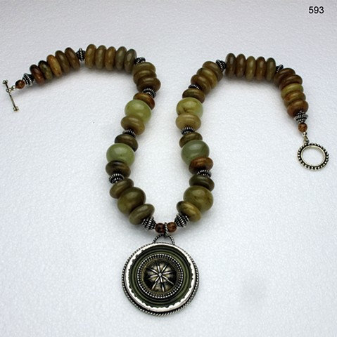 bezel set vintage celluloid & brass button with jade, silver beads & brass toggle (358)