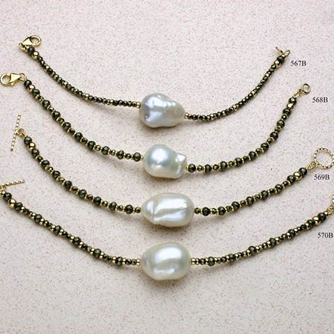 "delicate adornments for the wrist: a large single baroque pearl is surrounded by faceted pyrite and g/f beads, finished either with a g/f lobster clasp or toggle #567B is 7""; #568B is 7 1/2""; # 569B is 6 1/2""; # 570B is 7"""