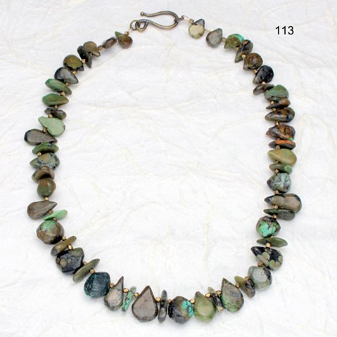 unusually cut turquoise, forest hues,  with brass findings (#113)