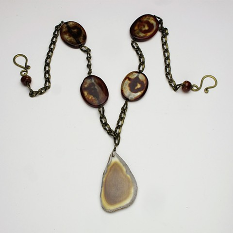 "earthy toned statement piece; an agate slice hangs from vintage brass chain and agate large flat beads, a brass hook and eye finishes the 26"" necklace, the pendant hangs 2 1/2""(#898)"