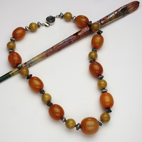 """vintage orange celluloid beads are complimented with yellow jade and silver beads, this 23"""" necklace is finished with a silver box clasp (#899)"""