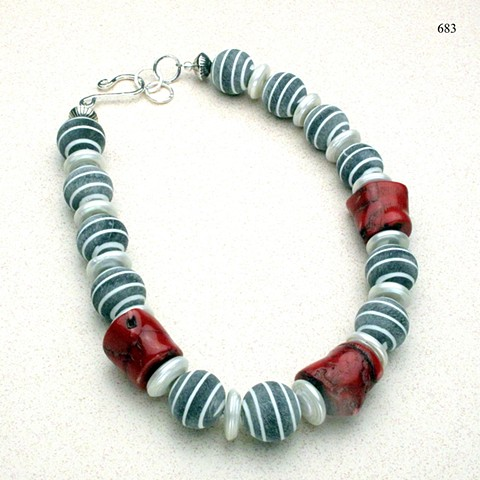 pinstriped gray flannel buffalo horn beads accented with coral & biwa disc pearls, finished with an adjustable  sterling silver hook & eye clasp (#683)