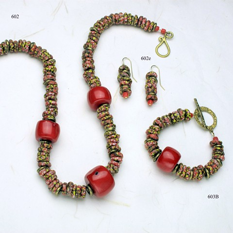 coordinating set of colorful glass beads from Benin, accented with large pieces of coral and Nigerian brass.  The necklace (602) is finished with a brass clasp; the bracelet (603B) has a bronze clasp; the earrings (602e) are on g/f wires.