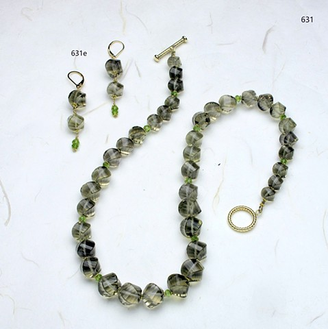 unusually faceted spiral cut smoky quartz accented with faceted peridot rondelles and vermeil spacers, finished with a g/f toggle clasp (631) coordinating earrings (631e)