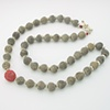 Ecuadoran antique clay carved beads accented with Chinese carved coral, sterling silver beads & toggle ( #671)