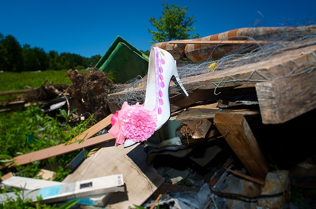 Drag queen's shoe in trash heap