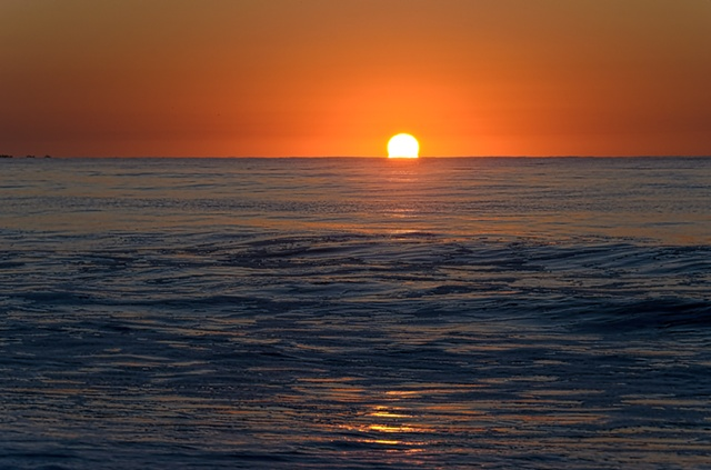 Sun rising over ocean at Cape May beach, October 2011
