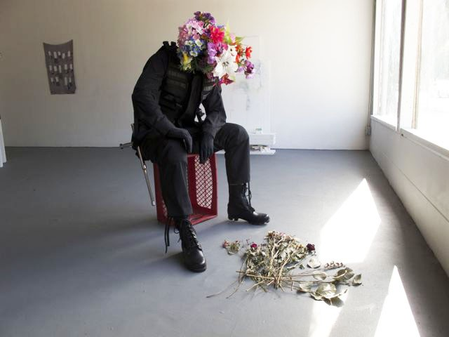 Kathryn Andrews Requiem and Reverb 2010 Flowers and borrowed artwork (Scott Benzel, The Flowering of Instrumental Reason, 2007, mixed media)