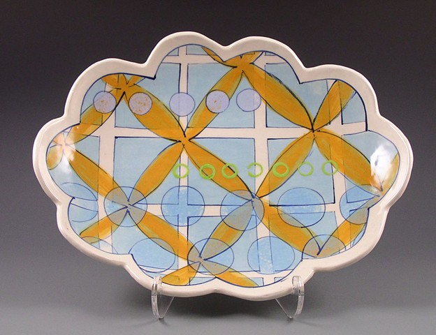 oval platter, medium, handbuilt with handpainted underglaze decoration, blue grid, orange flowers, geometric, modern