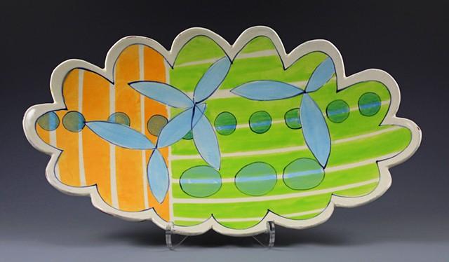 oval platter, large, handbuilt, handpainted decoration, green stripes, orange stripes, blue flowers, scalloped