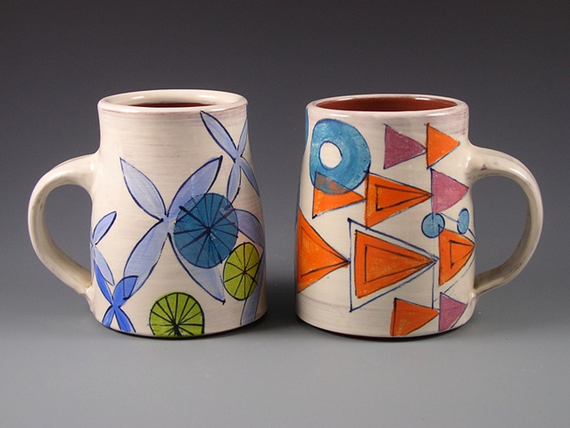 thrown earthenware mugs with slip, hand-painted underglaze and clear glaze