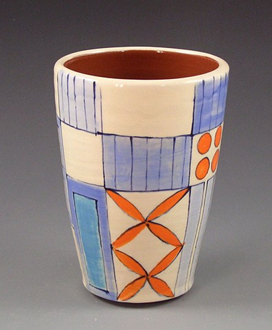 Tumbler, cup, wheel-thrown, handpainted, orange flowers, blue rectangles, stripes, dots