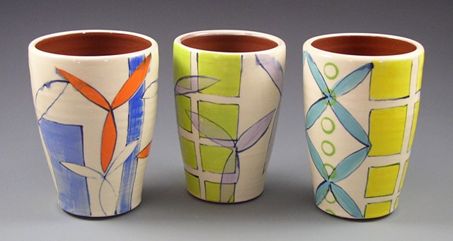 Tumblers, cups, wheel-thrown, handpainted, green, orange, blue, yellow dots, circles, rings, flowers, grid