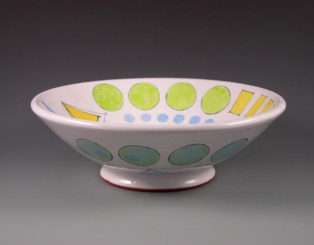 large thrown earthenware bowl with majolica glaze and hanpainted colorants
