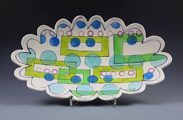hand-built oval platter with slip and underglaze decoration