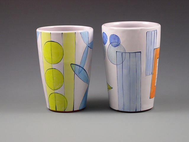 thrown terra-cotta tumblers, with handpainted majolica glaze