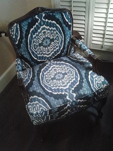 Pair of blue Ikatz bergere chairs