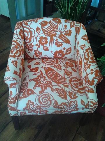 Pair of orange & creme chairs