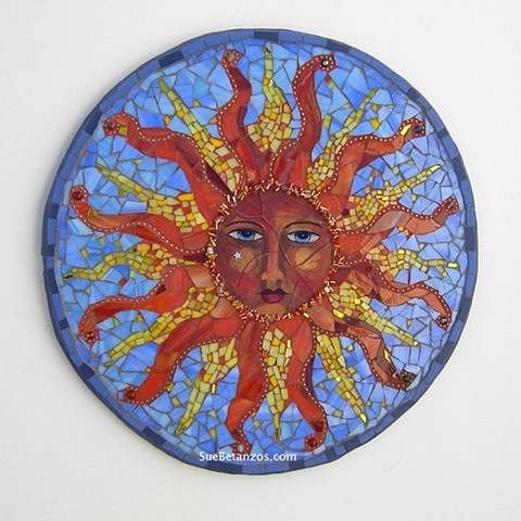 sue betanzos, glass mosaic, mirror mosaic, mosaic sun, magical sun, reverse glass painting sun, stained glass, gold, mirror, blue, glass, stones, vintage beads, red, orange, silver star, fantasy sun, folk