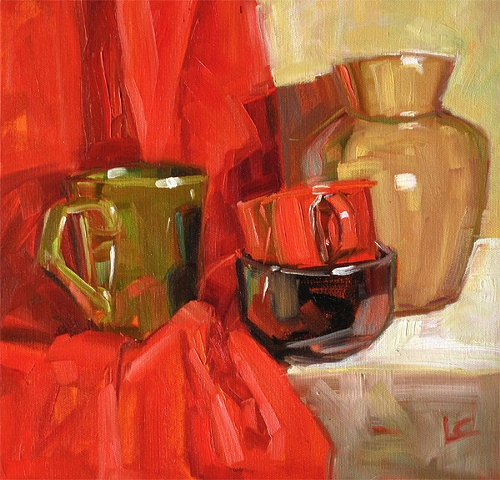 Still life with red cloth, green mug and black cup