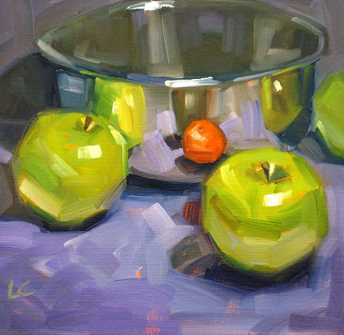 Still life with stainless bowl, green apples and mandarin orange