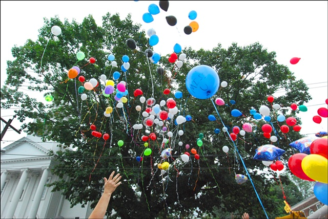 Southington, CT - Balloons inscribed with thoughts and prayers for Joseph Ozga are released during Apple Harvest Festival. Ozga died as a result of gunshot wound during a domestic incident. Photo by Margaret Waage