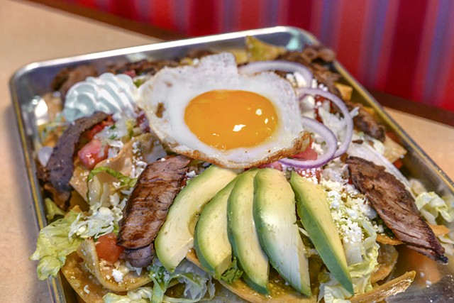 Salsa's Southwest Grill Leons Chilaquiles consists of nacho chips smothered in mild cheesy Verde or ranchero sauce topped with steak, lettuce, queso fresco, egg, avocado and sour cream.