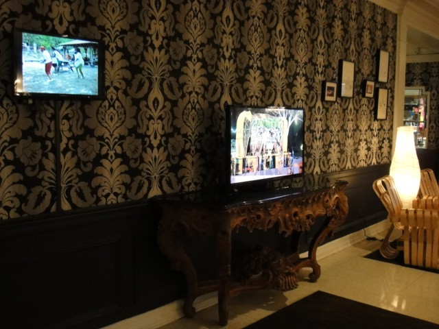 special 2-channel video installation with framed prints and photos at the Rubells' Capitol Skyline Hotel