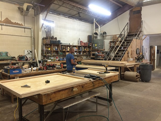 Working on panels in the wood shop at McDonough Structures in Iowa City.