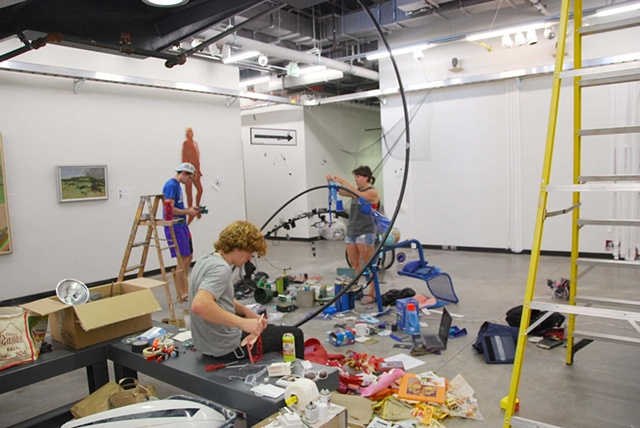 sculpture students building installation