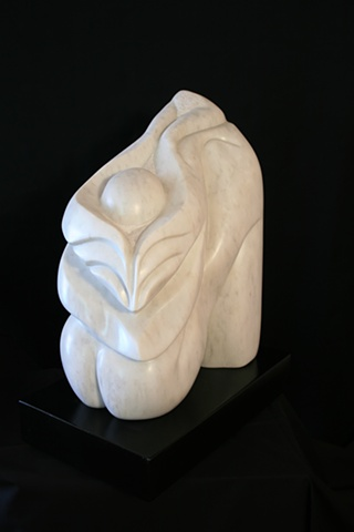This is a modern contemporary stone sculpture of  morphing of human and plant forms by Denis A. Yanashot