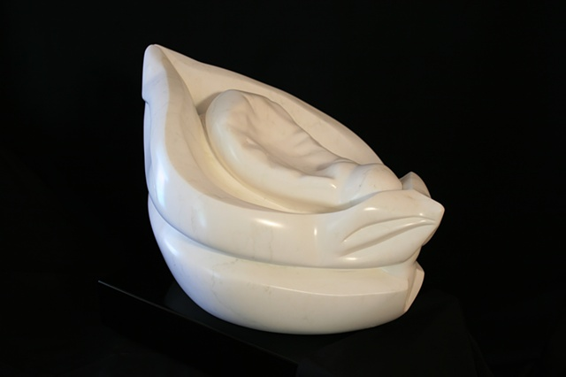 This is a modern contemporary stone sculpture of an imaginary interpretation of a dried-out seed pod  by Denis A. Yanashot