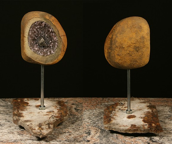 This is the 4th piece of the Geode Series.  Comprised of stone, light sensitive color changing glass, coal and epoxy.