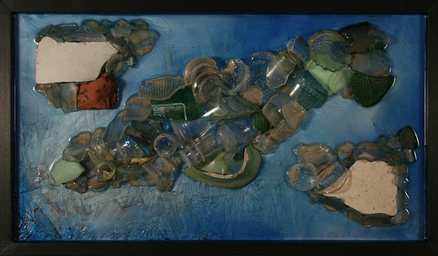 Reappearance is a mixed media hanging wall relief by Scranton, Pennsylvania sculptor Denis A. Yanashot. This hanging wall relief is composed of Lackawanna River detritus found along its banks.  Mostly glass and some ceramic bits form the main subject matt