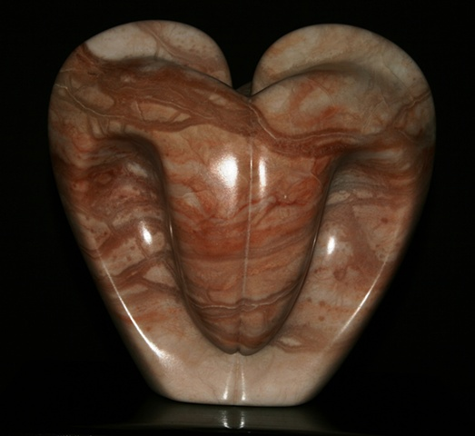 This is a comtemporary stone sculpture of a pink bleeding heart  by Denis A. Yanashot.