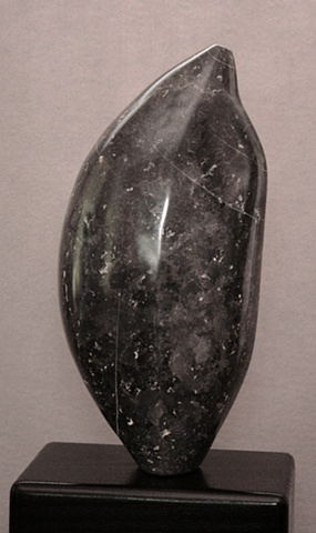 This is a comtemporary stone sculpture of a very healthy and well-nourished seed by Denis A. Yanashot.