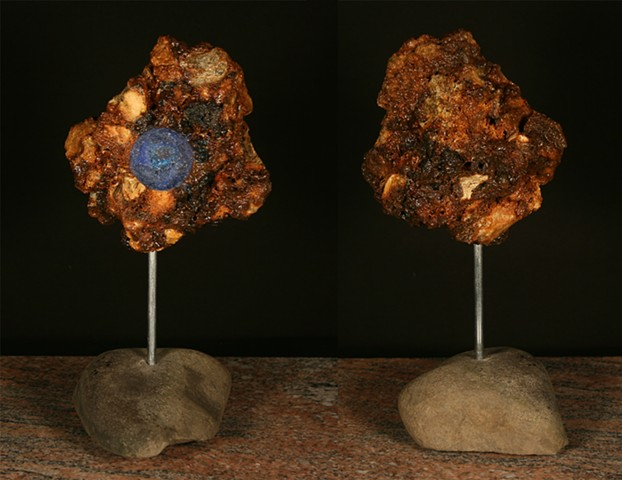 "This mixed media sculpture of the ""geode series"" consists of a carved anthracite burnt culm mass, polyurethane, epoxy resin, mica powder and glass frit."