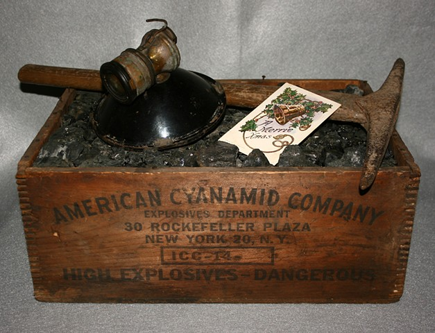 Anthracite monkey vein coal miner's Christmas gift of coal, pick and carbide light in explosive box.