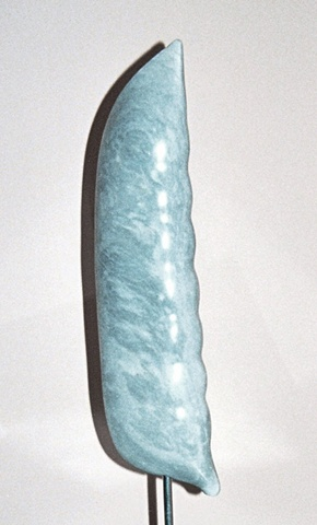 This is a modern contemporary stone sculpture of a pure up-scaled representation of a snap pea by Denis A. Yanashot