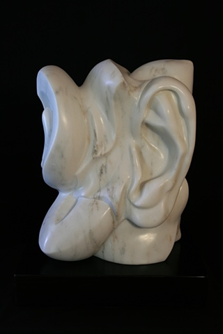 This is a modern contemporary stone sculpture of human and plant forms by Denis A. Yanashot
