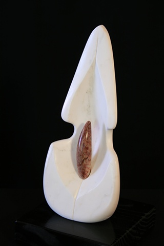 This is a modern contemporary stone sculpture of a flower bloom with pistil by Denis A. Yanashot