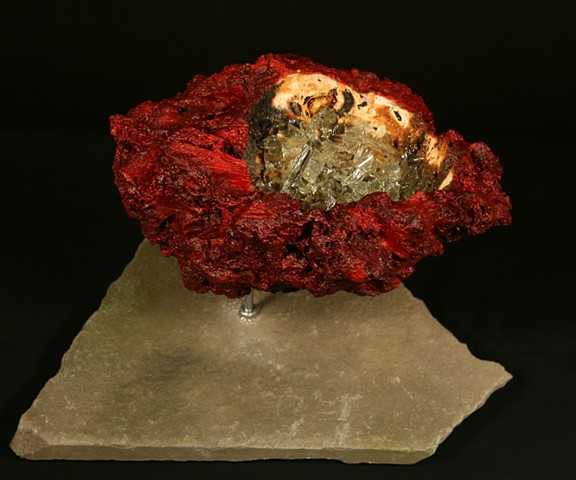 This is the 7th piece of the Geode Series.  It is comprised of a carved anthracite burnt culm mass, glass shards and oil paint.