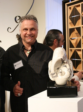 "Denis A.Yanashot with his sculpture entitled ""Catasetum""."