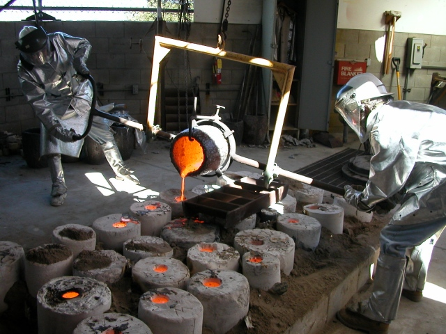 Pouring the  bronze