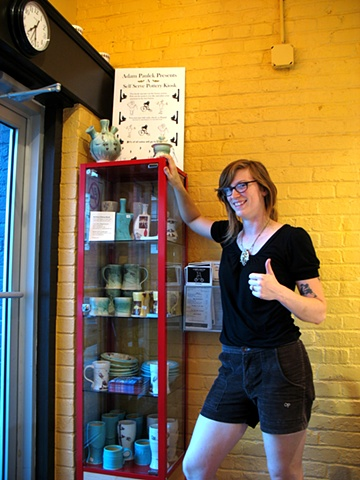 Noell, an owner of the Lamplighter Coffee Shop with a Self Serve Pottery Kiosk