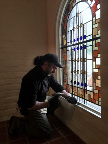 working on a window by Arthur Stern, Architectural Glass artist.